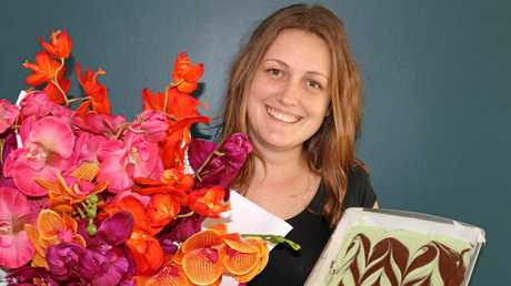 Blossoms Flower Boutique's Katie Allen will soon open a cafe expansion at her shop.