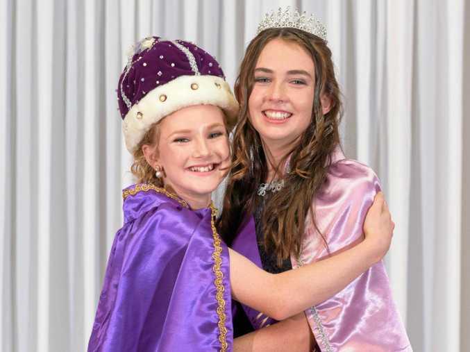 HUGS: 2016 Junior Jacaranda Queen Maeve Dougherty, left, and Princess Kate Smith.