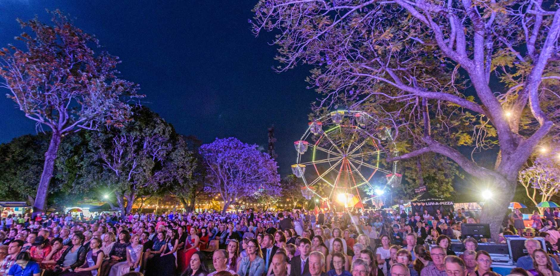 A large crowd gathered under the Jacaranda and the carnival lights to watch the Jacaranda Queen crowning ceremony
