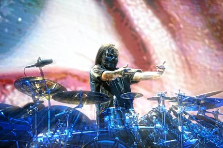 Jay Weinberg stands up from behind the drumkit during Slipknot's performance at the Brisbane Entertainment Centre.