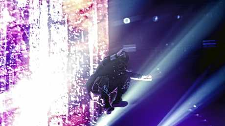 Sid Wilson jumps from the back of the stage during Slipknot's set at the Brisbane Entertainment Centre.