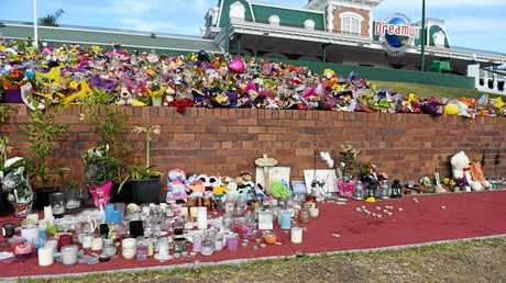 Flowers left on the front lawn at Dreamworld after a terrible tragedy where four people lost their lives.