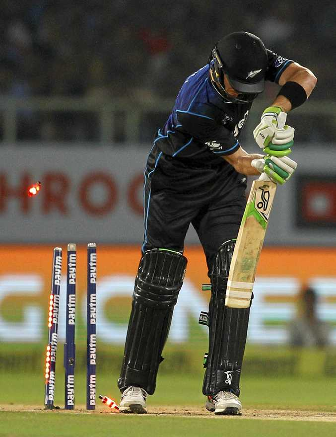 New Zealand's Martin Guptill is bowled by India's Umesh Yadav during their fifth and final one-day international cricket match in Visakhapatnam, India.