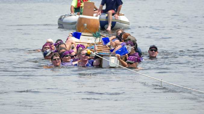 SPILL: The CV Forward Steps dragon boat crew  end up in the water even as rescuers tow  the boat to shore.