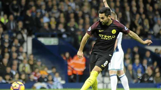Manchester City's Ilkay Gundogan scores his first goal and his side's third during the English Premier League soccer match against West Bromwich Albion at the Hawthorns.