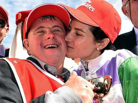 Steven (left) and Michelle Payne celebrate after Michelle rode Prince of Penzance to victory in the Melbourne Cup at Flemington Racecourse in Melbourne, Tuesday, Nov. 3, 2015. (AAP Image/Julian Smith) NO ARCHIVING, EDITORIAL USE ONLY