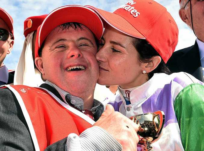 Steven and Michelle Payne celebrate Prince Of Penzance's victory in last year's Melbourne Cup.