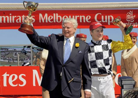 Trainer Bart Cummings and jockey Blake Shinn hold their trophies after winning the Melbourne Cup in 2008 with Viewed.