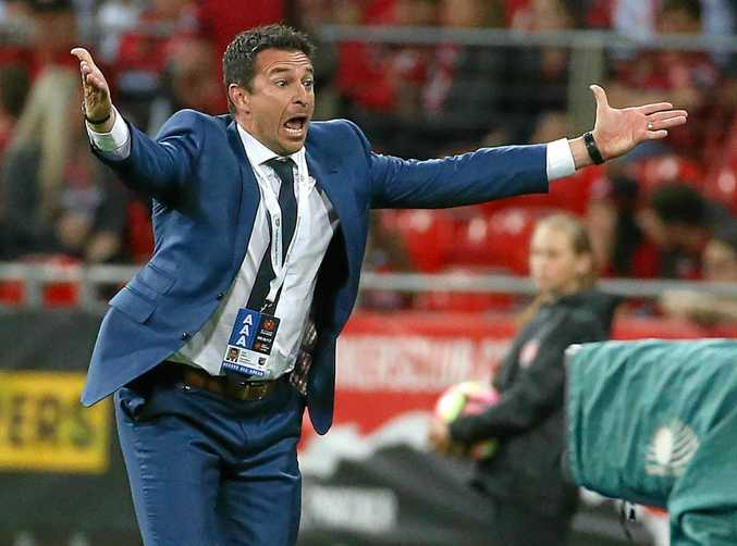 Mariners coach Paul Okon reacts after one of his players missed a scoring chance during the round 4 A-League match against the Western Sydney Wanderers.