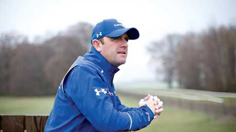 Godolphin trainer Charlie Appleby watches trackwork.