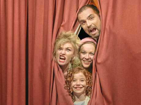 Paul Oehlmann (Oliver Warbucks), Tracie-marie Seipel (Grace Farrell), Margaret Ramsey (Miss Hannigan) and Piper Ramsey (Annie) ham it up before they take to the stage for the Clarence Coast Theatrical Society's performance of Annie over the next two weeks.