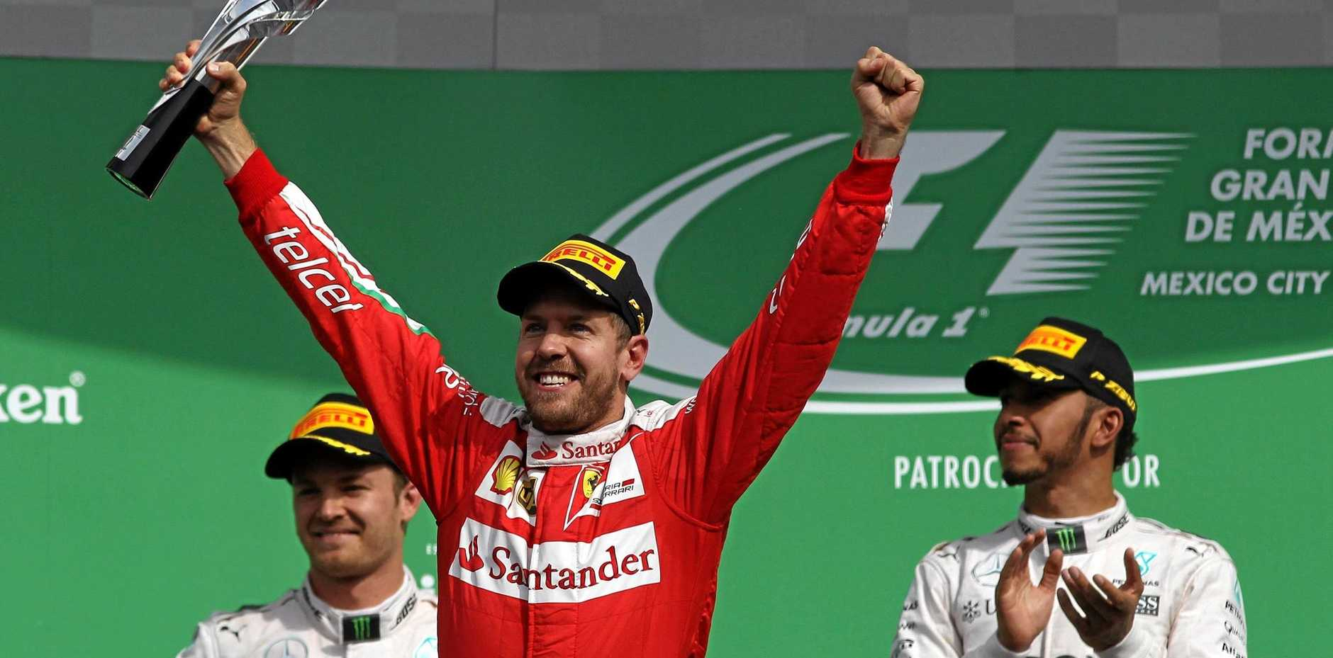 Sebastian Vettel celebrates finishing third in Mexico.