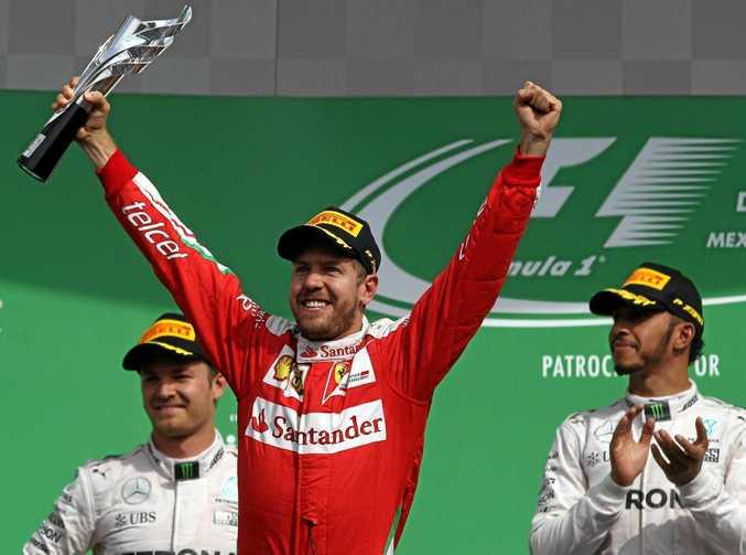 Sebastian Vettel celebrates finishing third in Mexico.