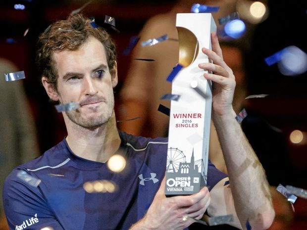 Andy Murray holds the trophy after winning the Erste Bank Open.