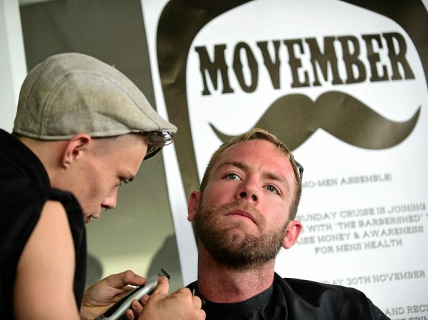 The Sunshine Coast has built a strong tradition in the Movember campaign. Ben Boulter, from The Barber's Shed, is shown here preparing to work on Daniel Scott at Drift Bulcock Beach where there was a shave-off to celebrate the end of Movember.