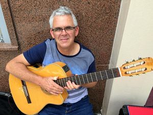 Six string sounds fill the Jacaranda streets
