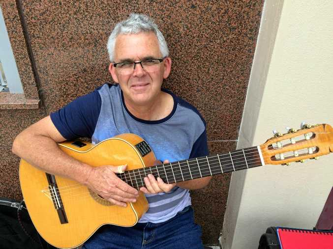 Mick Carr is one of many buskers taking part as part of the Jacaranda Busking playing outside Toast Espresso.