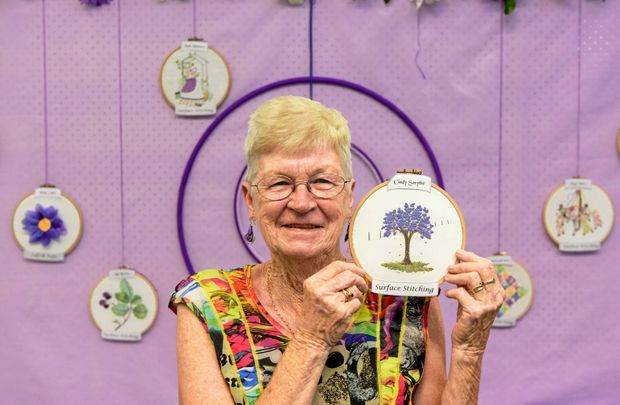 Treasurer of the Jacaranda Embroidery Group Cindy Smythe shows off one of the small scale group project works they did for their biennial Jacaranda Exhibition.