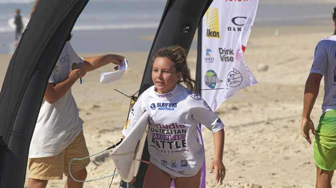 GUN GROMMET: Wooli's Carly Shanahan was the top junior competitor surfing for Coffs Harbour.