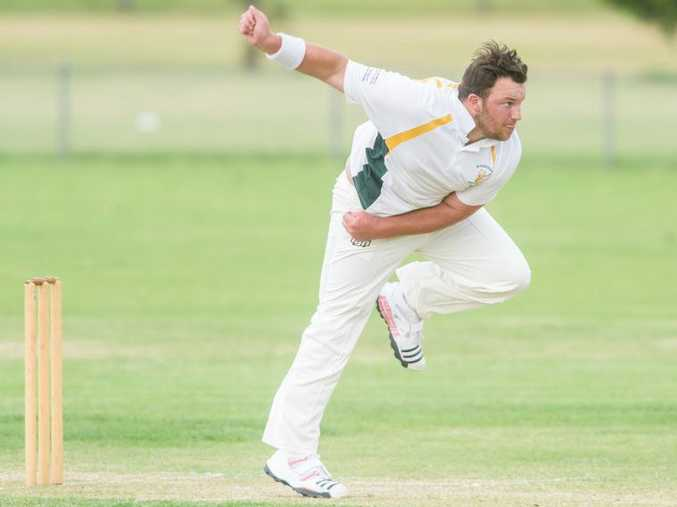 Brandon Honeybrook sends down a delivery downwind for Wanderers against Iluka at Barry Watts oval.