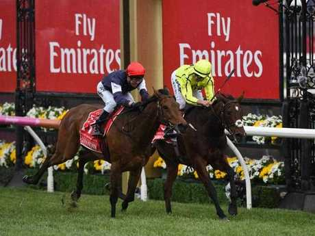 Almandin (left), ridden by Kerrin McEvoy, wins the Melbourne Cup at Flemington Racecourse in Melbourne, on Tuesday, Nov. 1, 2016.