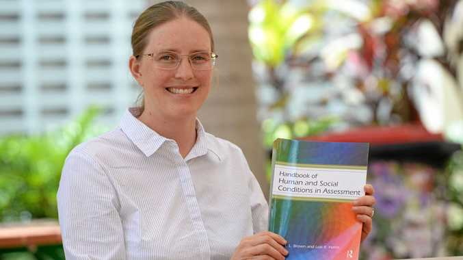HOMEWORK HELP: Dr Lois Harris from CQ University with her new co-authored text book Handbook of Human and Social Conditions in Assessment.