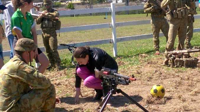GUN DRILL: Bessie Wilson learns the ropes with a machine gun at the Army Open Day at Woodenbong.