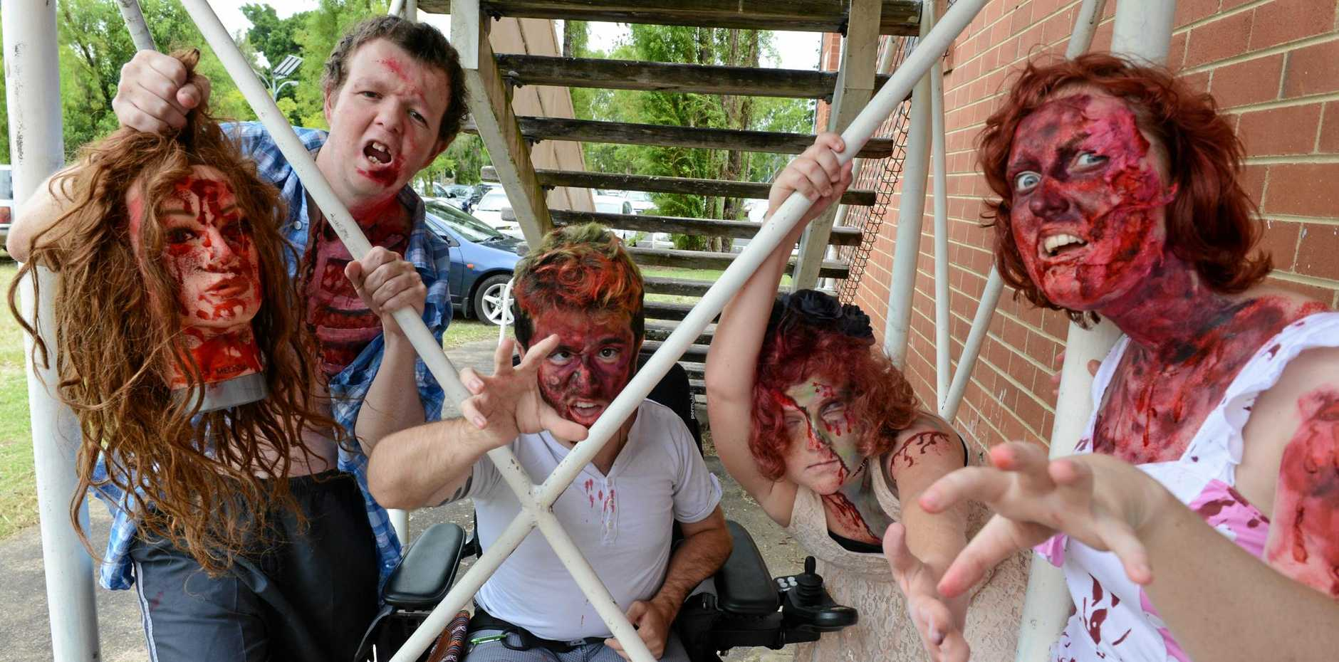 FROM LEFT, Maverick Walker 19, Kristian Keogh, 20, Kaatja Rose Pond, 21, and Krystal De La Porte, 10, prepare for the Zombie Walk.