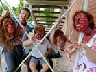 FROM LEFT, Maverick Walker 19, Kristian Keogh, 20, Kaatja Rose Pond, 21, and Krystal De La Porte, 10, prepare for the Zombie Walk.
