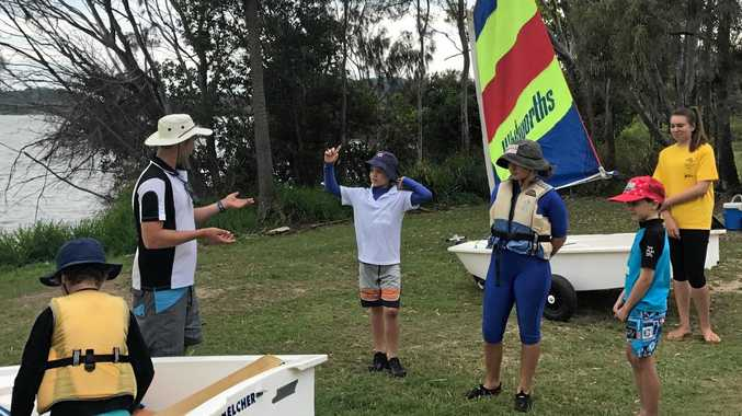 COME AND TRY: Trainer Brent Pearson, pictured with some of KBSC recent learn to sail participants, is keen to see the whole community come along and try sailing on the open day, November 5.