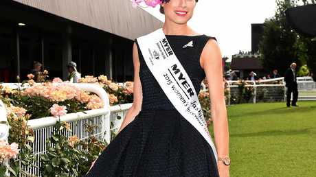 CLASS: 2015 Fashions on the Field winner Emily Hunter poses for photographs during Oaks Day.