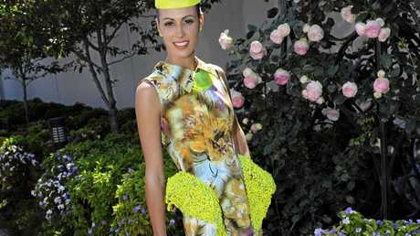 COLOUR POP: 2012 FOTF winnerAmy Robson poses for a photo on Oaks Day.