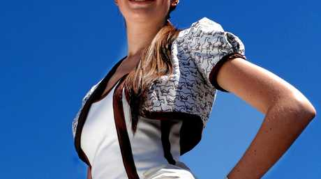Nineteen-year-old Sarah Schofield poses for a photo after winning the Fashion on the Field event on Oaks Day at Flemington Racecourse in Melbourne, Thursday, Nov. 9, 2006. Oaks Day is traditionally the \