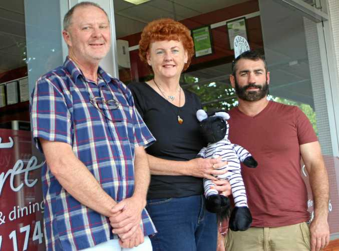 HEALTH SUPPORT: Helen McDonald (centre), with husband Evan and Cherry Tree cafe owner Scott Morton, is striving for awareness of neuroendocrine tumours, the rare cancer she was diagnosed with last year.