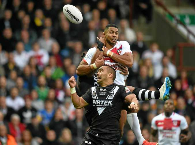 Thomas Leuluai of New Zealand competes with Kallum Watkins of England during their Four Nations clash at the John Smith's Stadium in Huddersfield.