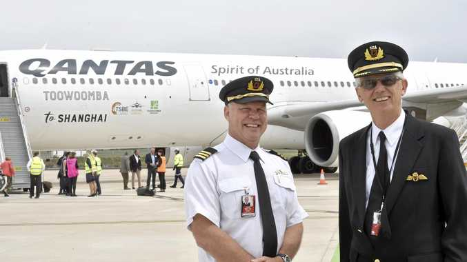 RETURN FLIGHT: Captain Peter Campbell (right) and first officer Craig Freier with the Qantas A330 which Capt Campbell flew to Wellcamp from Sydney for the historic flight to Shanghai.