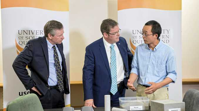 GRANTS: USQ researcher Dr Zuhua Zhang (right) shows deputy vice-chancellor (research and innovation) Professor Mark Harvey (left) and Member for Groom Dr John McVeigh his work which he has received funding for.