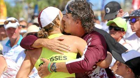 CLOSE: Jordan Mercer is embraced by father Darren FILE PHOTO