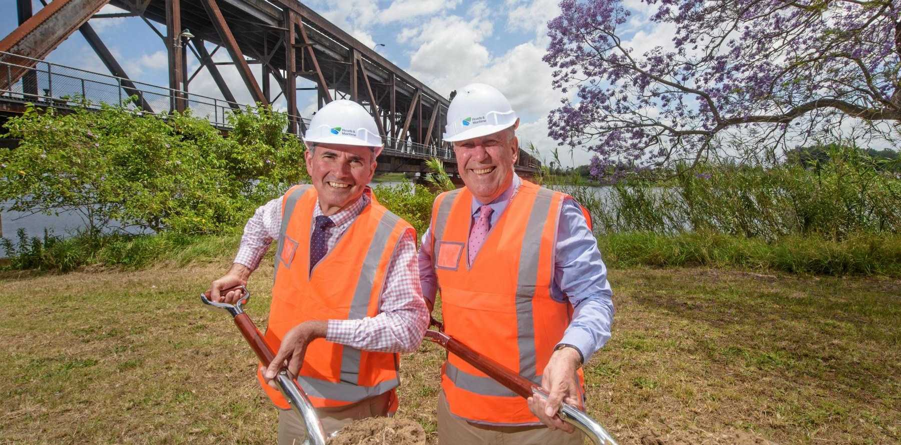 Member for Clarence Chris Gulaptis and Minister for Roads Duncan Gay turn the first sod for the construction process of the new Grafton bridge.