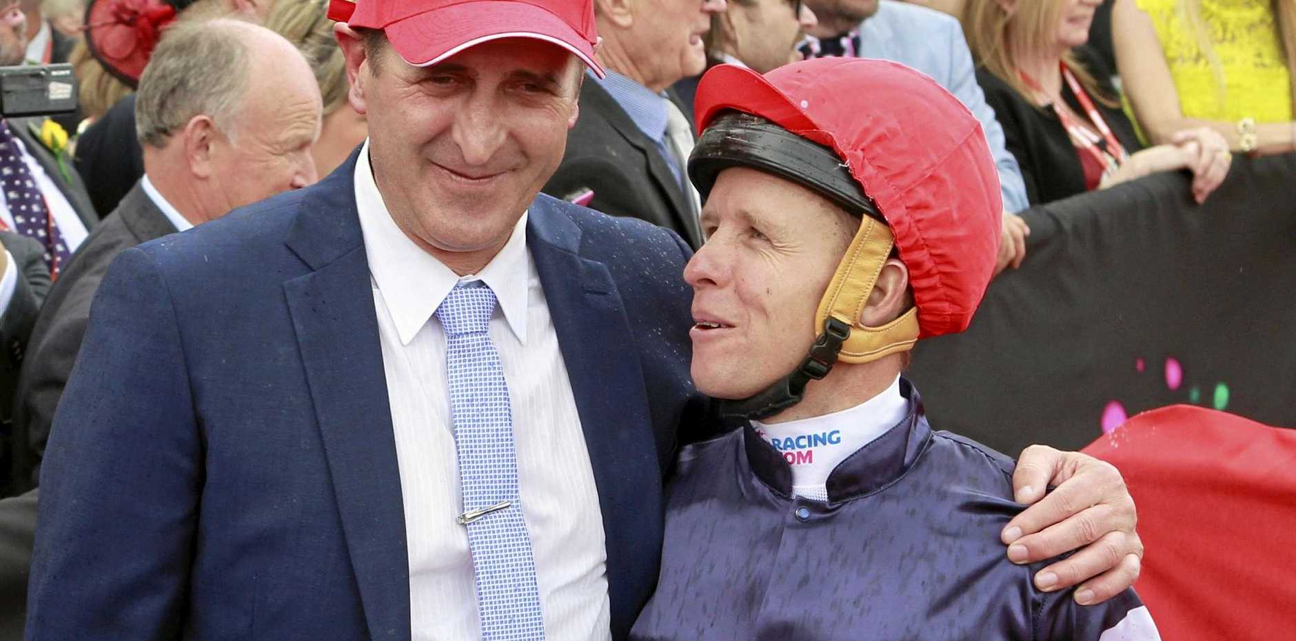 Jockey Kerrin McEvoy (right) and trainer Robert Hickmott celebrate after Almandin won the 2016 Melbourne Cup.