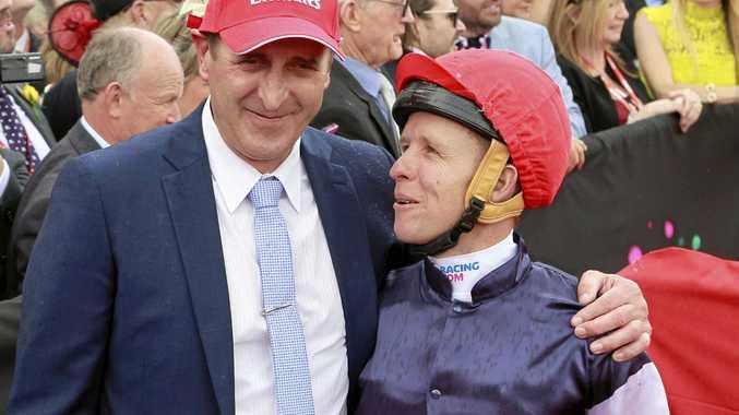 Jockey Kerrin McEvoy (right) and trainer Robert Hickmott celebrate after Almandin won the 2016 Melbourne Cup.