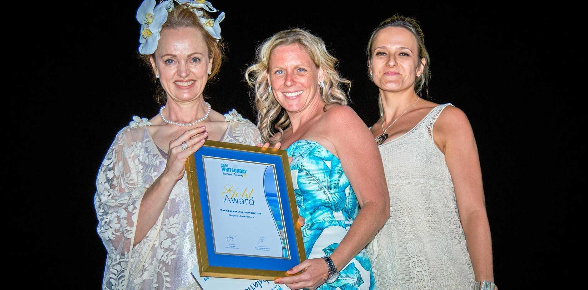 HOSTS: Elizabeth Hackett, Tara Tissington and Louise Bomitali accept Magnums' Backpacker Accommodation award.