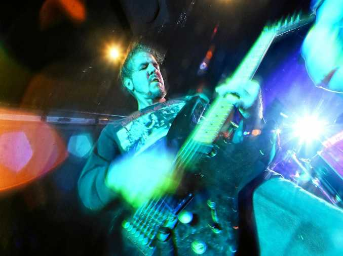 Guitarist Luke Gough rips into a song during a Violent Sun show. The teacher and musician is behind the latest incarnation of Jacarok, an all-ages concert and Jacaranda Festival finale.