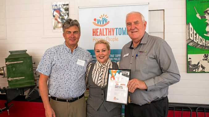 HAPPY AND HEALTHY: Cooloola Human Services Network representatives (from left) Peter Blashki, Cass Elstrob and Gary Davidson celebrate collecting the Connections with Place Award in the 2016 Healthy Towns Awards.