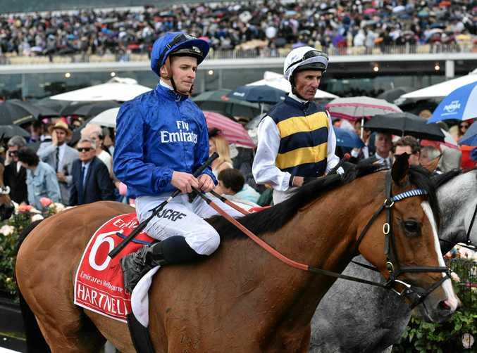 Jockey James McDonald (left) returns to scale on Hartnell after the finishing third in the Melbourne Cup.