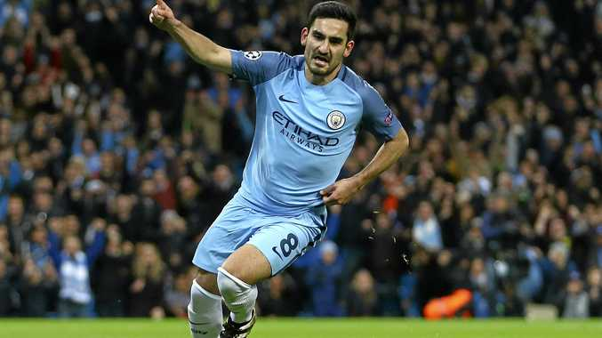 Manchester City's Ilkay Gundogan celebrates after scoring his side's first goal during the Champions League group C match against Barcelona at the Etihad Stadium in Manchester.
