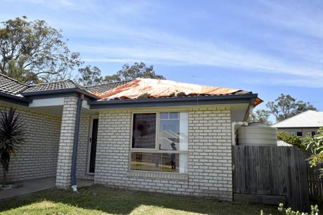 Mark Winning's Darling Heights Home where some of the roof was ripped off during a storm.