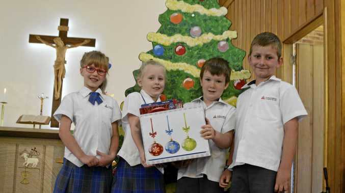 CHRISTMAS CHEER: Concordia Lutheran College year one students (from left) Summer Kimmins, Millie Goldsworthy, Jack Evans and Brock Gililand are making sure other families have a happy Christmas.