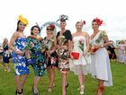 Fashions on the field winners pose for a photo at the Tweed River Jockey Club on Melbourne Cup day.