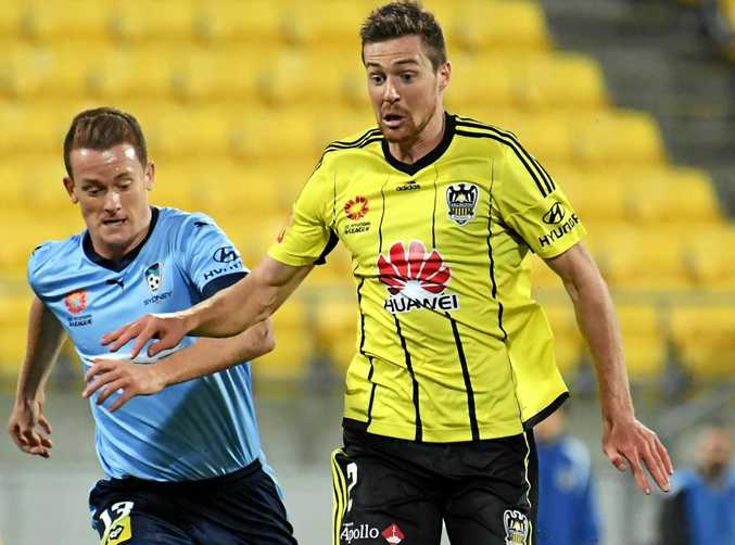 Jacob Tratt of the Phoenix (right) is challenged by Brandon O'Neill of Sydney FC.
